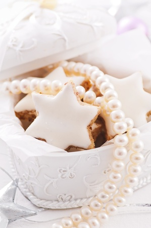 Present box with sweets and pearl necklace photo