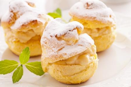 Bigne stuffed with pastry cream photo