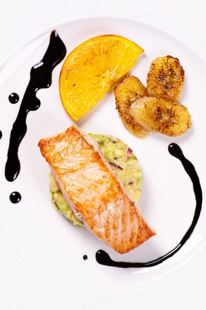 Salmon with avocado tartare and caramelised banana photo