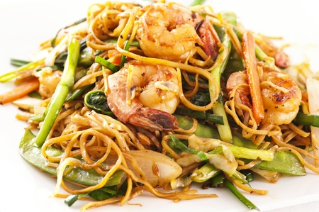 Stir-fried noodles with shrimps and vegetables photo