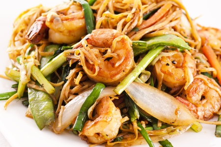 Stir fried noodles with vegetables and prawns photo