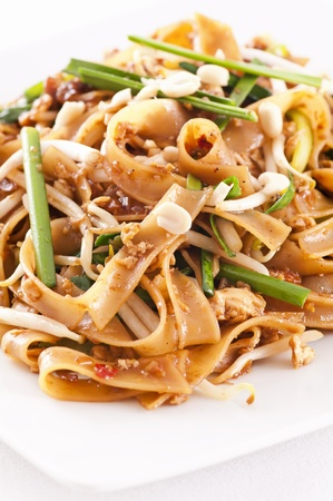 thai noodle: Pad Thai on the white plate Stock Photo