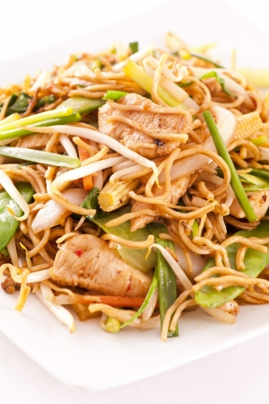 asia food: chinese stir - fried noodles with chicken