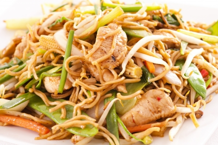 chinese stir fried noodles with chicken photo