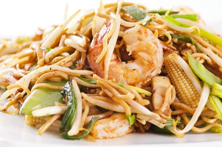 stir-fried noodles with prawns and vegetables photo