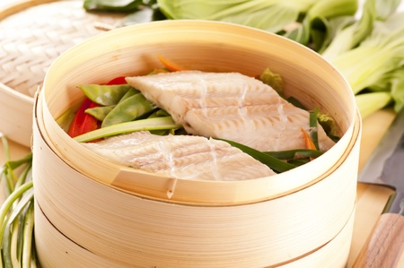Fish fillet steamed with vegetables  photo
