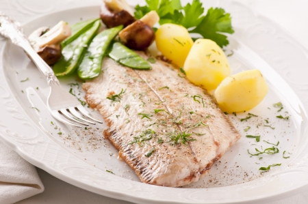 salt water fish: sole fried with potato and mushrooms