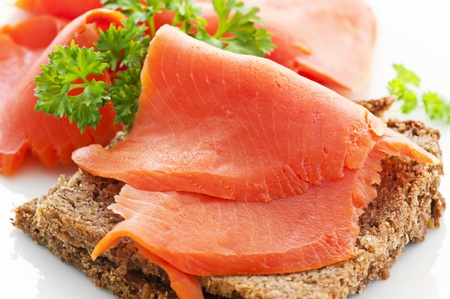 wild salmon slices on the bread photo