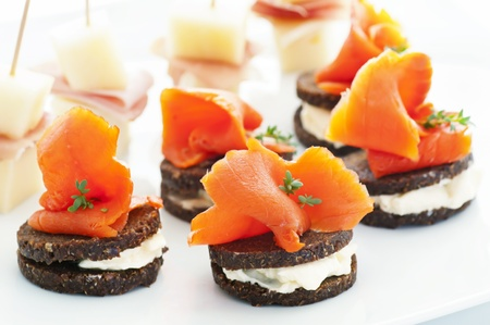 canapes: Finger food with salmon and ham