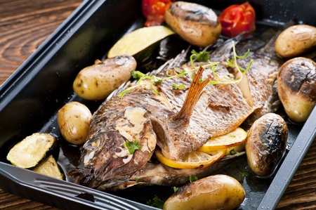Tilapia roasted with vegetables photo