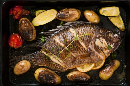 Fish roasted with vegetables photo