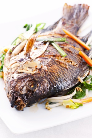 Tilapia fried with vegetables photo