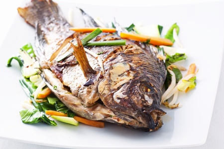 Tilapia fried with asian vegetables  photo