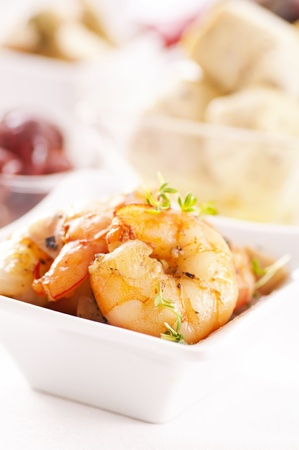 Tapas with prawns and artichokes photo
