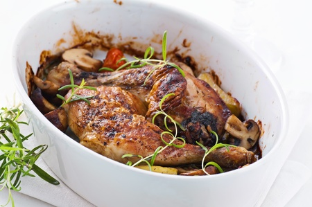 chicken legs roasted with the vegetables  photo
