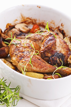 Chicken legs roasted with the mushrooms photo