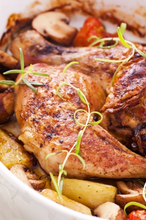 chicken fingers: Chicken legs roasted with vegetables Stock Photo