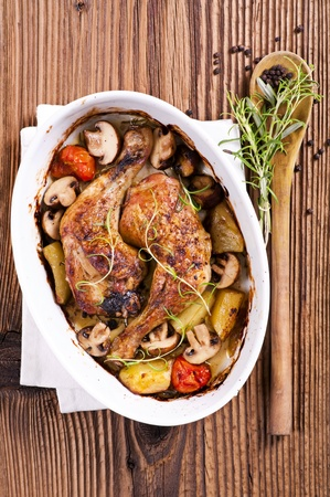 Chicken legs roasted with vegetables  photo