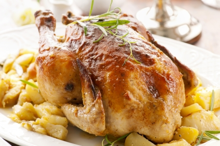christmas turkey: Chicken with potato roasted Stock Photo