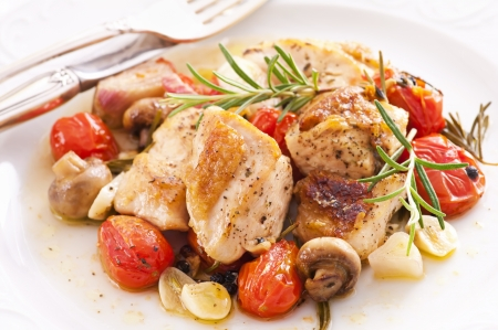 chicken breast: Chicken fillet roasted with vegetables and herbs Stock Photo