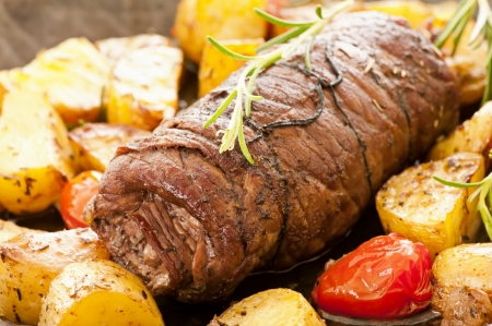 roulade: Beef roulade with roasted potato and tomato Stock Photo