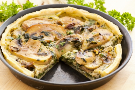 Quiche with spinach and mushrooms photo