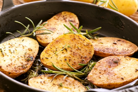 Roasted potato with rosemary photo
