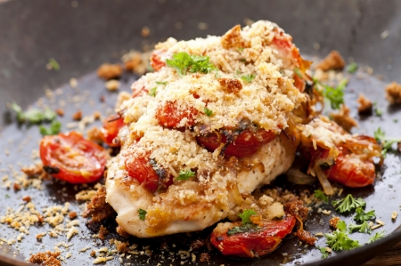 red breast: Chicken fried with salsa and parmesan Stock Photo
