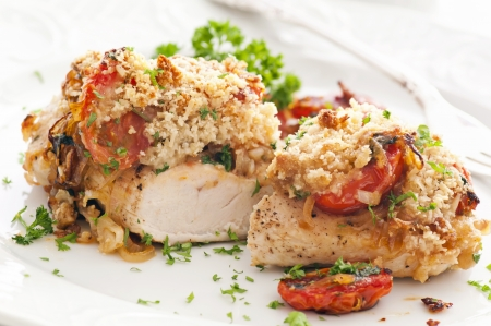 red breast: chicken baked with tomato and parmesan Stock Photo