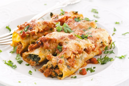 ricotta cheese: cannelloni with spinach ricotta filling Stock Photo
