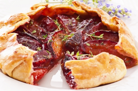 Pastry with plums and thyme photo