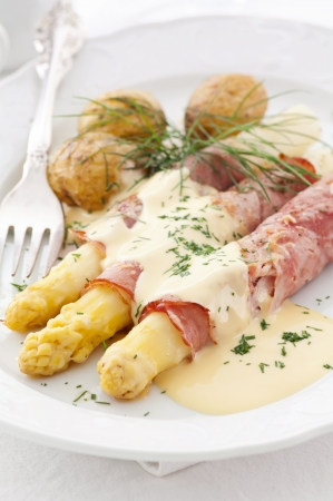 Asparagus with ham and sauce photo