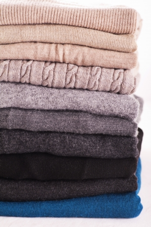 warm things: wool sweaters on white background
