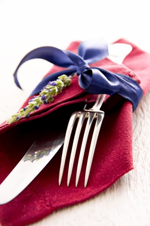 cutlery with red napkin photo