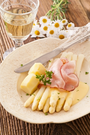 white asparagus with ham and potato photo