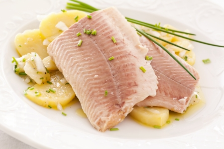 smoked trout with potato salad photo