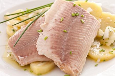 fish fillet with potato salad photo