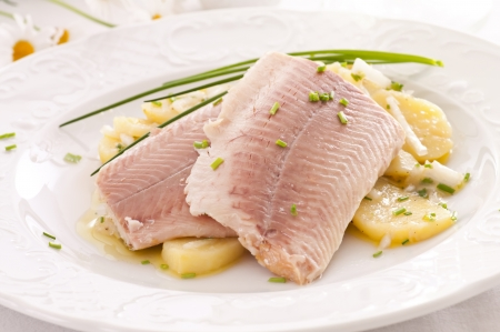 edible fish: fish fillet with potato salad Stock Photo