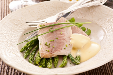 fish fillet with green asparagus photo