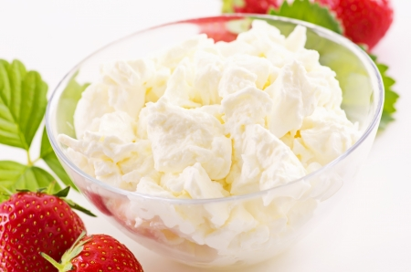 curd: fresh white curd with strawberries Stock Photo