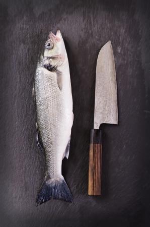 fish with santoku knife photo