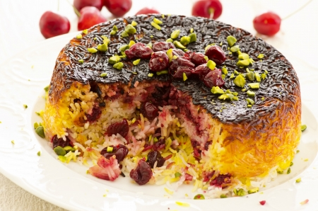 sour cherry: persian rice tah-dig with cherries Stock Photo