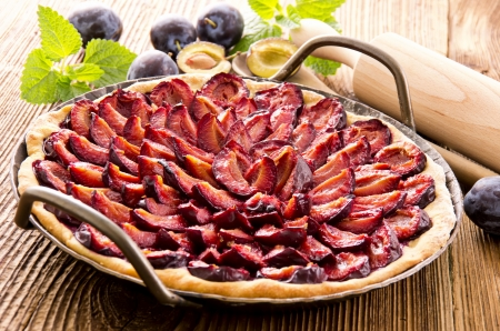 afters: plum pie in the baking form Stock Photo