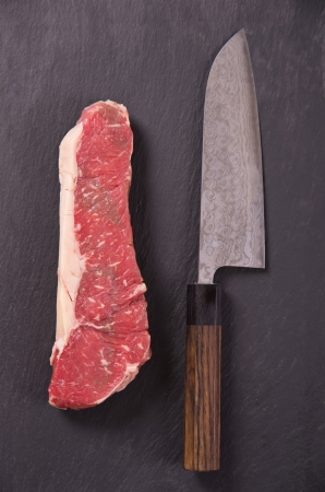 beef steak with santoku knife photo