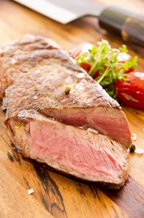 prime rib: beef steak on the wooden plate Stock Photo
