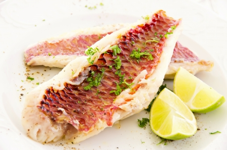 fish fillet with fresh lime and herbs photo