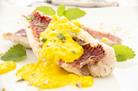 goatfish: red mullet with saffron sauce Stock Photo