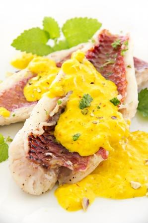 goatfish: fish fillet with saffron sauce Stock Photo
