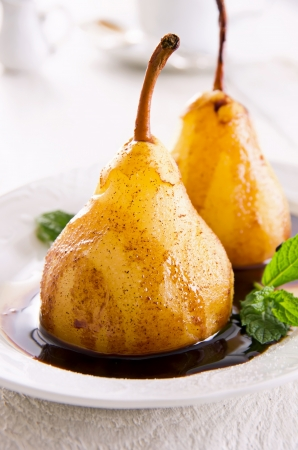 dekorated: pears poached in amaretto with chocolate sauce