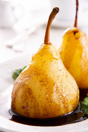 poach: pears cooked in wine with chocolate sauce Stock Photo